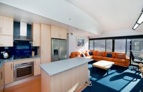 Kitchen, lounge area on Oasis Houseboat - Moored at Customs House Houseboat Marina